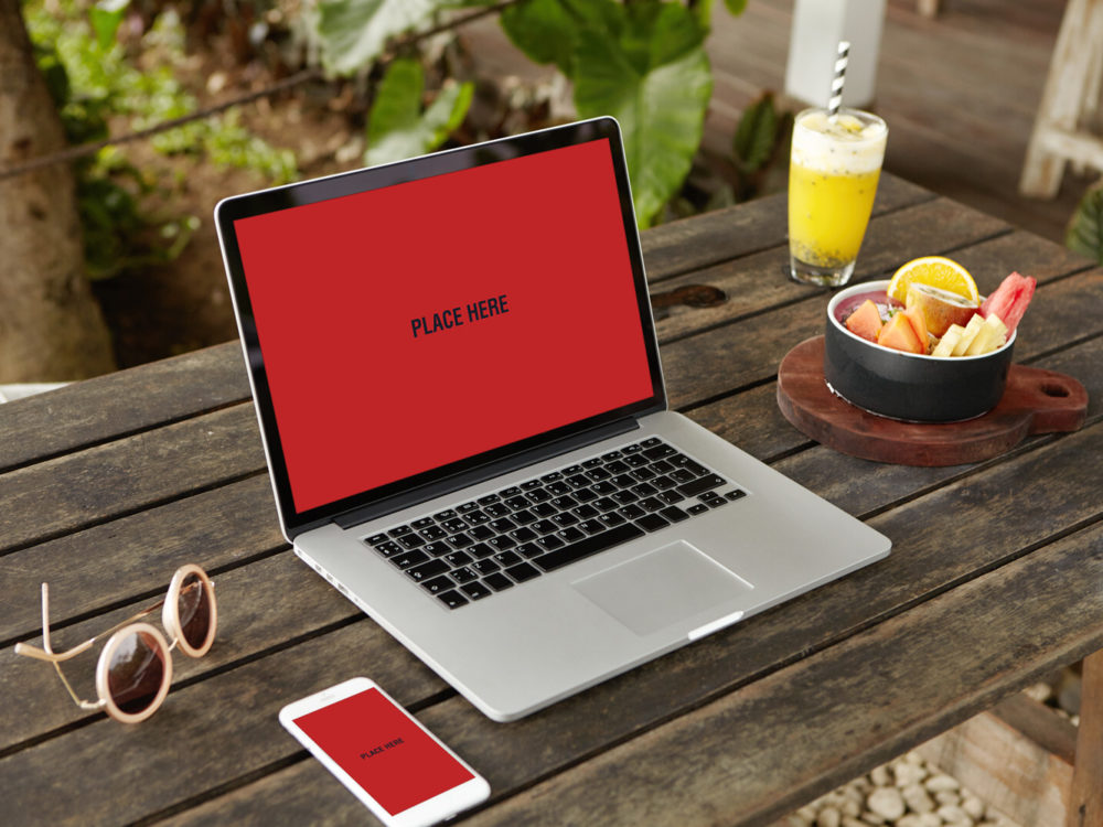 free smartphone with laptop mockup on wooden table mockup