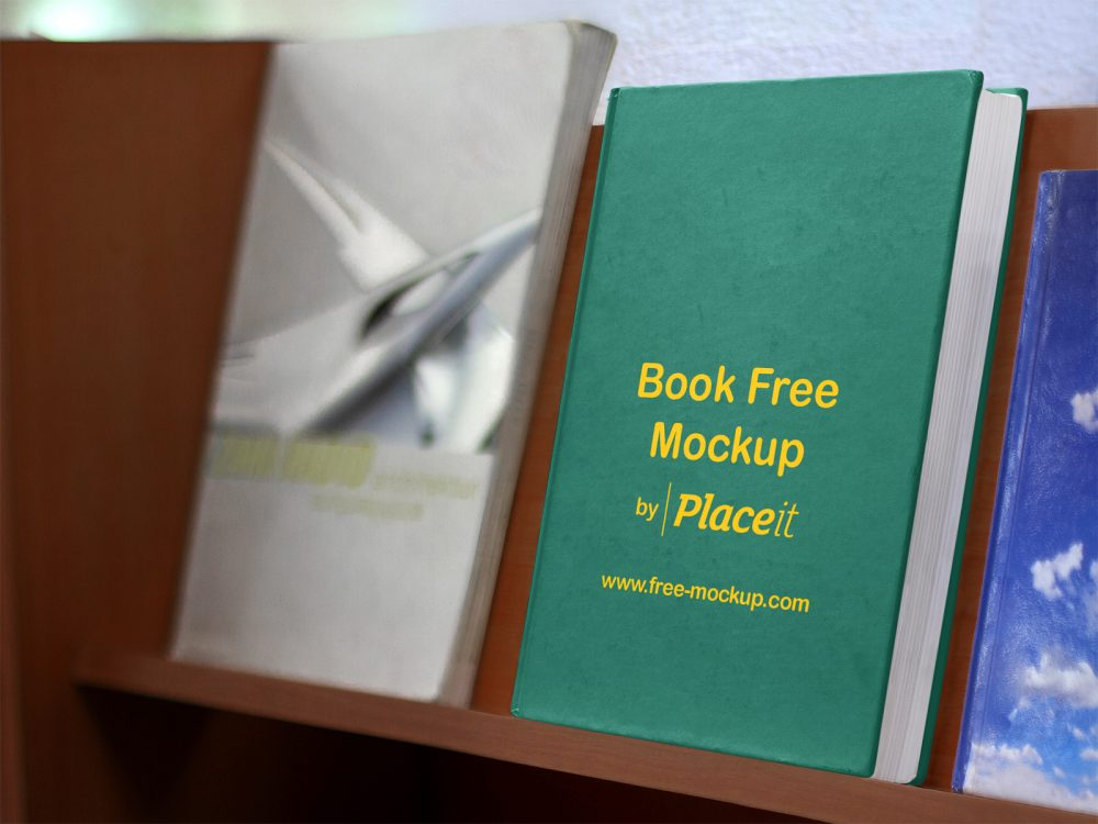 free hard cover book on a wooden bookshelf placeit mockup