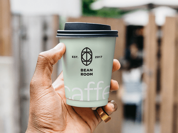 Hand Holding Cup Free PSD Mockup